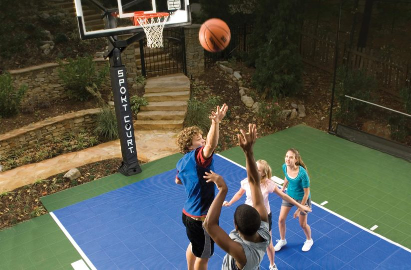 Kids playing basketball in backyard